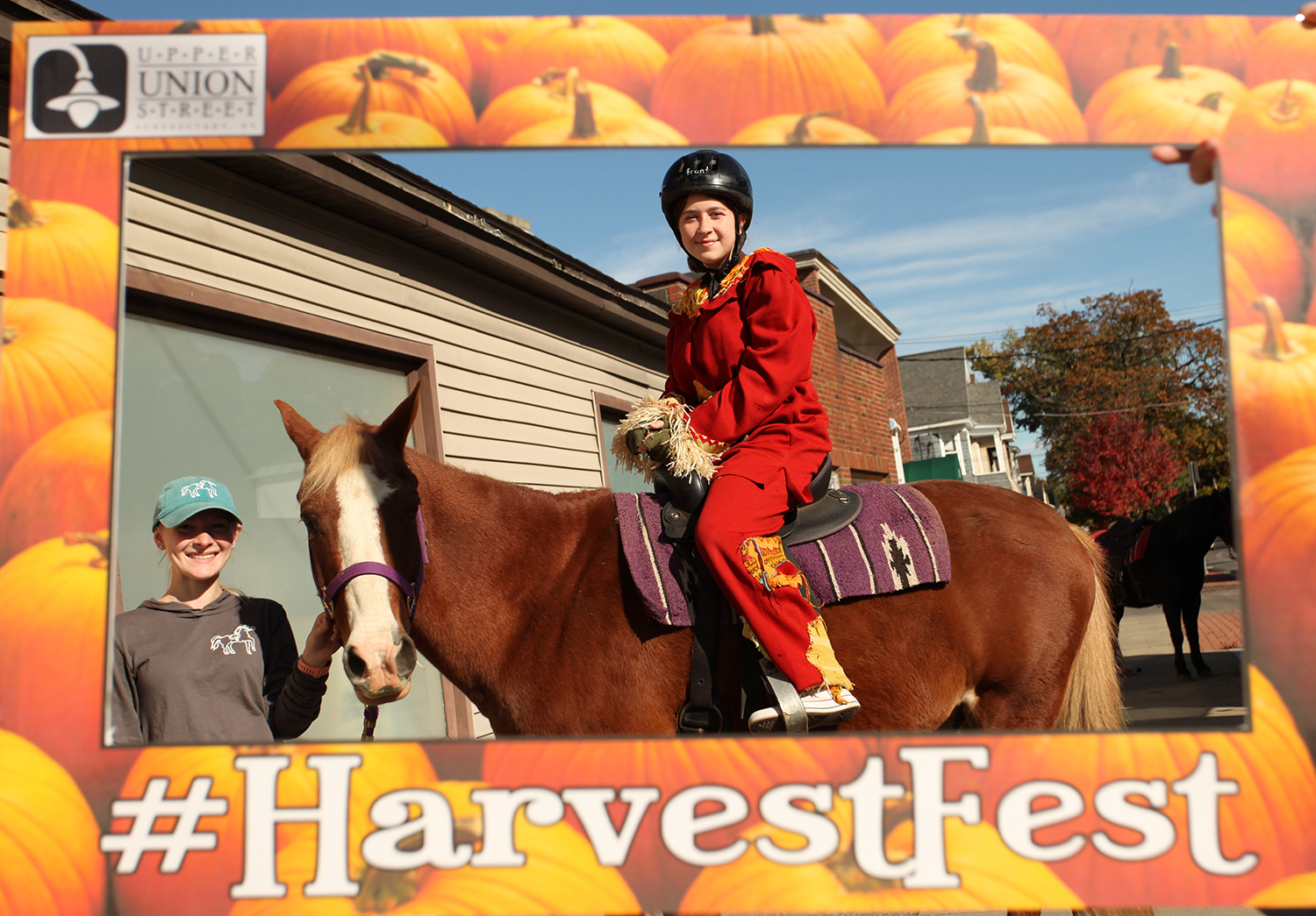 girl riding horse inside a harvest fest frame