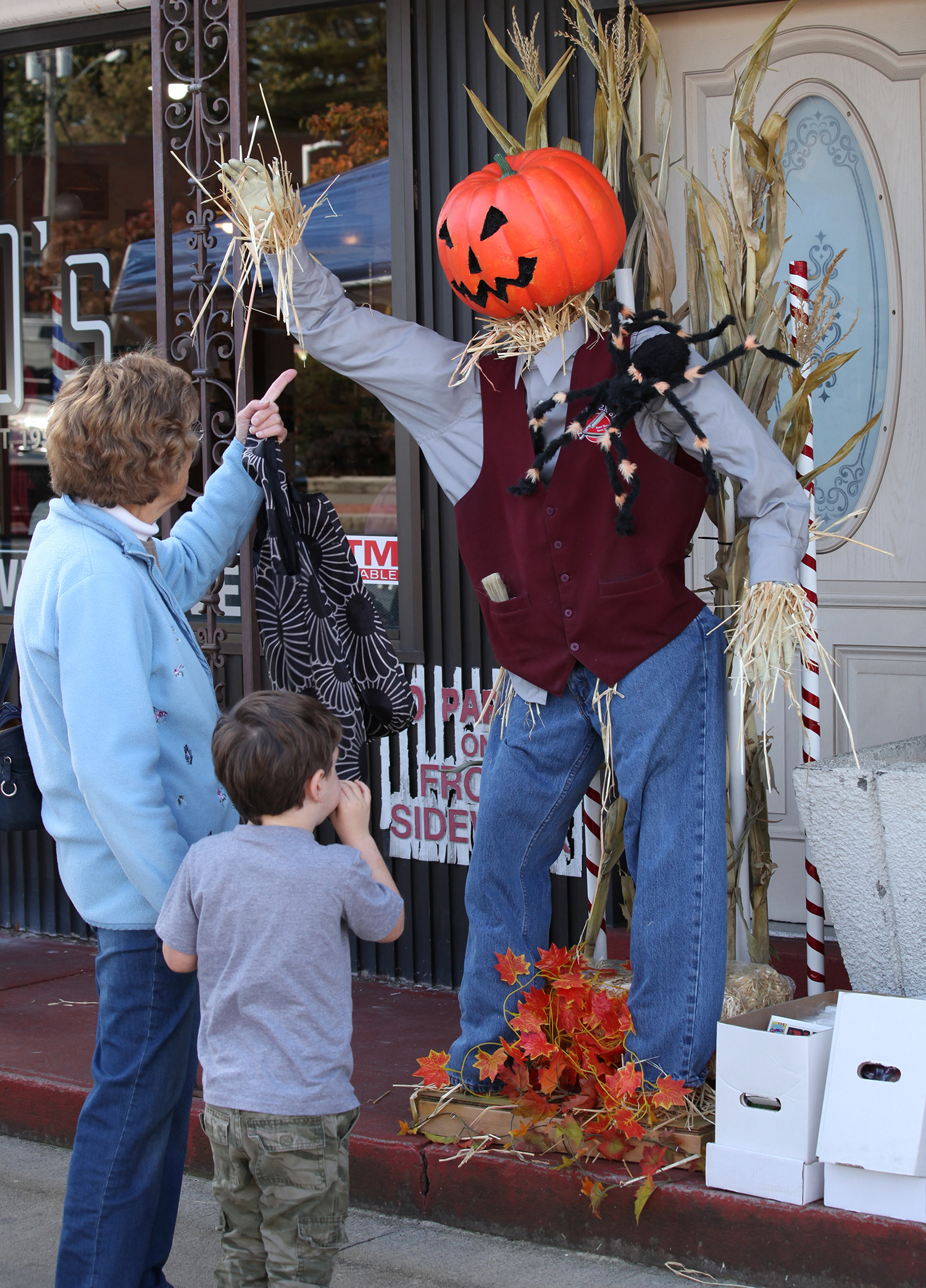 harvest fest woman pointing at pumkin man
