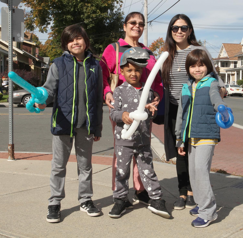group of kids holding balloon swords